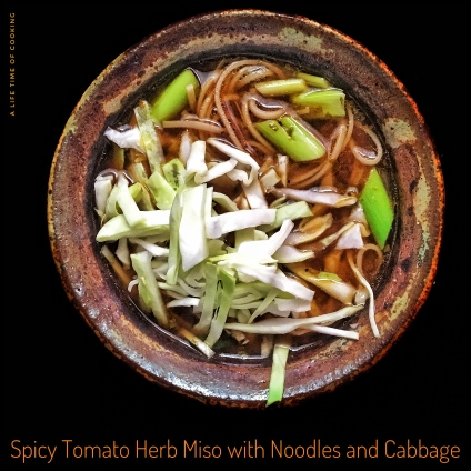 Spicy Miso Soup with Tomato-Herb Broth, shredded Cabbage and Spring Onions